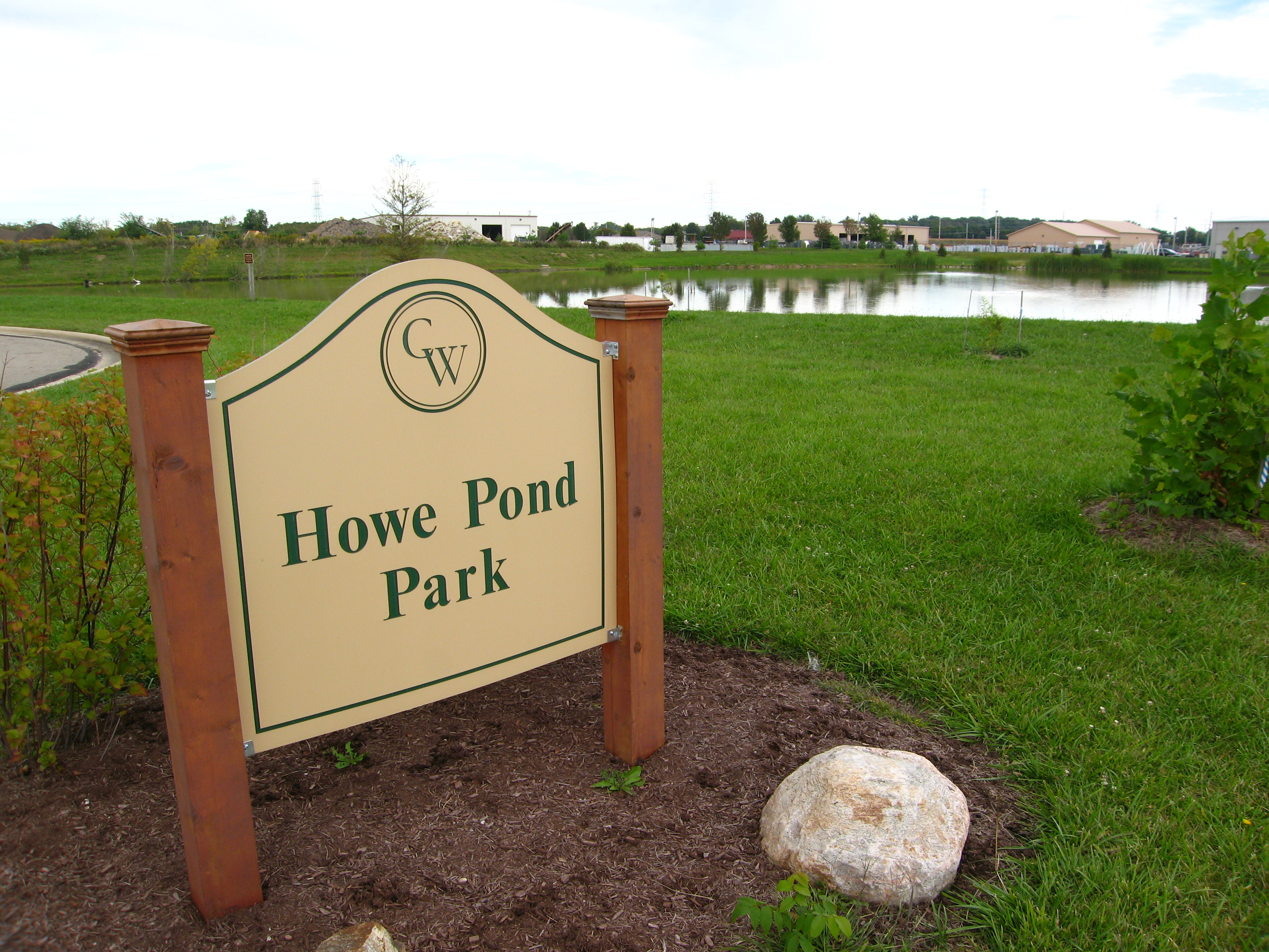 Howe Pond Park Beige Sign